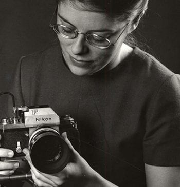 Virginia Geren, photographer for UM Photo Services, holding camera