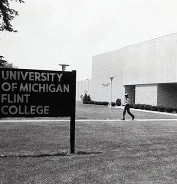 Young man walking outside UM Flint College