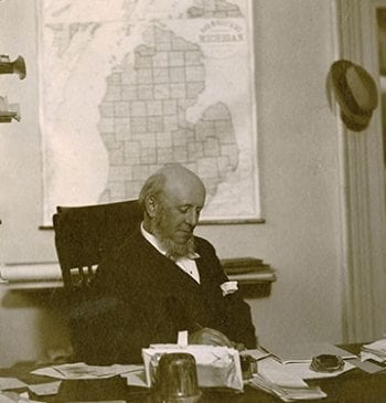 Angell at desk
