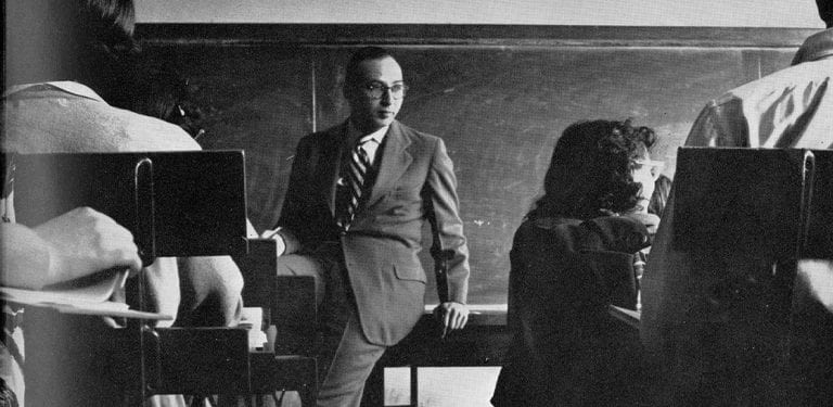 "Professor seated in front of class ""chock full of knowledge,"" 1951"