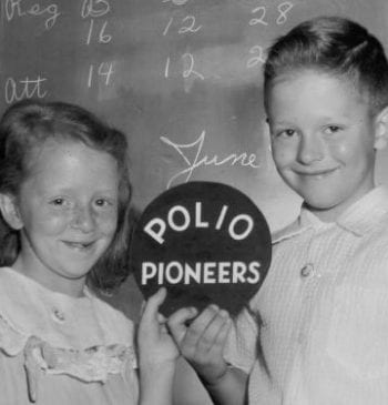 Children holding Polio Pioneers sign