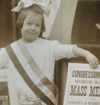 Child with women's suffrage posters